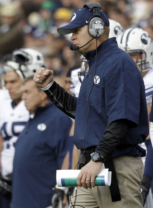 Brigham Young coach Bronco Mendenhall reacts to an interception during the first half of an NCAA college football game against Notre Dame in South Bend, Ind., Saturday, Oct. 20, 2012. (AP Photo/Michael Conroy)
