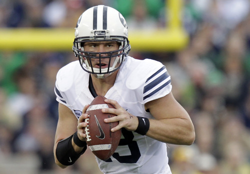 Brigham Young quarterback Riley Nelson looks to throw against the Notre Dame during the first half of an NCAA college football game in South Bend, Ind., Saturday, Oct. 20, 2012. (AP Photo/Michael Conroy)