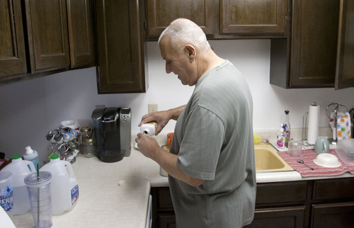 Steve Griffin | The Salt Lake Tribune  Mike McConkay pours a capful of medicine he must take in the kitchen of his Sandy, Utah home Wednesday October 3, 2012.   Mike, and his wife Denise, have faced health challenges his entire life, and now doctors say he needs a liver transplant. The costs associated with his transplant are overwhelming. Though fully insured, their medical bills are mounting faster than they can pay them. With fundraising and penny pinching they manage to keep creditors at bay. But with insurers charging higher co-pays and covering less, it's getting harder.