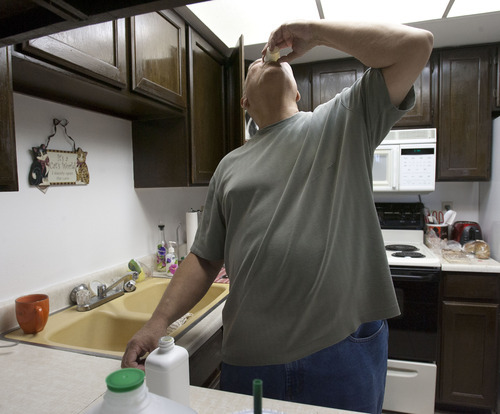 Steve Griffin | The Salt Lake Tribune  Mike McConkay drinks a capful of medicine he must take in the kitchen of his Sandy, Utah home Wednesday October 3, 2012.   Mike, and his wife Denise, have faced health challenges his entire life, and now doctors say he needs a liver transplant. The costs associated with his transplant are overwhelming. Though fully insured, their medical bills are mounting faster than they can pay them. With fundraising and penny pinching they manage to keep creditors at bay. But with insurers charging higher co-pays and covering less, it's getting harder.
