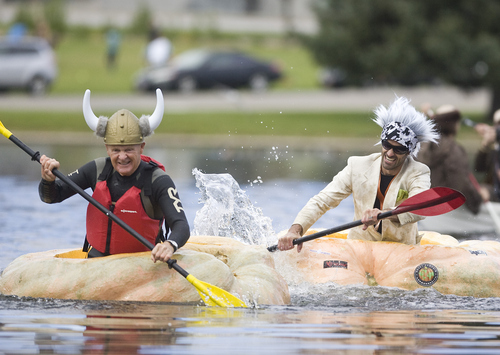 Keith Johnson |  The Salt Lake Tribune Seventy-seven-year-old Ross Bowman, left, paddles his