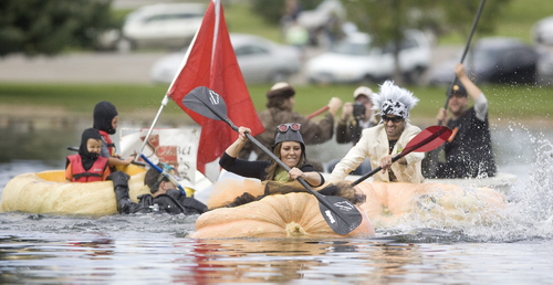 Keith Johnson |  The Salt Lake Tribune Carrie Fox and her husband, Kyle, take the lead while racing during the 2nd annual Ginormous Pumpkin Regatta October 20, 2012 at Sugar House Park in Salt Lake City. Participants in costume raced giant pumpkins -- some weighing over 1,000 pounds -- across the pond.