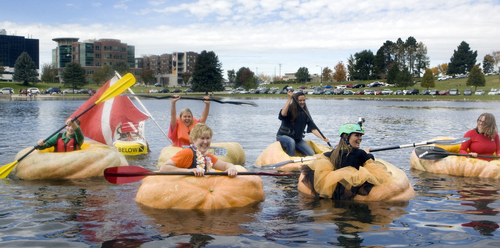 Keith Johnson |  The Salt Lake Tribune Women participating in the 2nd annual Ginormous Pumpkin Regatta paddle their pumpkins -- some weighing over 1,000 pounds -- across the finish line October 20, 2012 at Sugar House Park pond in Salt Lake City.