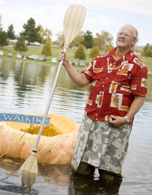 Keith Johnson |  The Salt Lake Tribune David Bradley stands next to his pumpkin