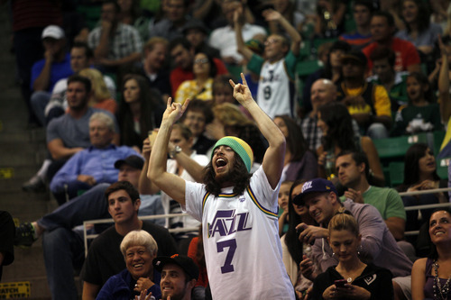 Ashley Detrick     The Salt Lake Tribune A Jazz fan cheers during the game against the Clippers on Saturday, Oct. 20, 2012 at Energy Solutions in Salt Lake City. The Jazz beat the Clippers, 99-91.