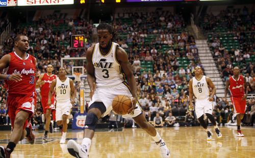 Ashley Detrick     The Salt Lake Tribune DeMarre Carroll drives the ball down court in the second half of the game against the Clippers on Saturday, Oct. 20, 2012 at Energy Solutions in Salt Lake City. The Jazz beat the Clippers, 99-91.