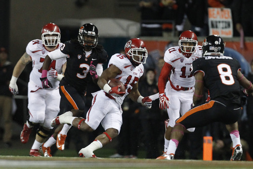 Chris Detrick  |  The Salt Lake Tribune Utah Utes running back John White (15) runs past Oregon State Beavers safety Anthony Watkins (3) and Oregon State Beavers safety Tyrequek Zimmerman (8) during the first half of the game at Reser Stadium on Saturday, Oct. 20, 2012.