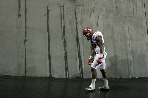 Chris Detrick  |  The Salt Lake Tribune Utah Utes running back John White (15) walks off of the field after the game at Reser Stadium Saturday October 20, 2012. Oregon State won the game 21-7.