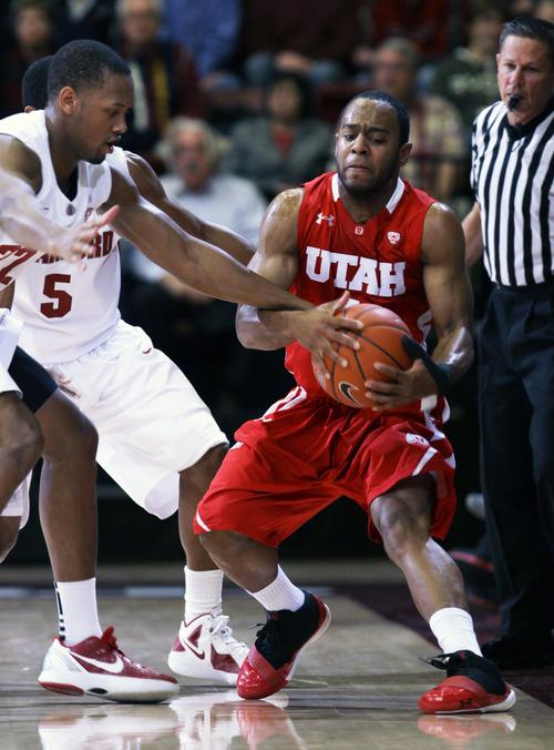 Stanford guard Jarrett Mann, left, pressures Utah guard Glen Dean (1) during the first half of an NCAA college basketball game in Stanford, Calif., Thursday, Jan. 12, 2012. (AP Photo/Paul Sakuma)
