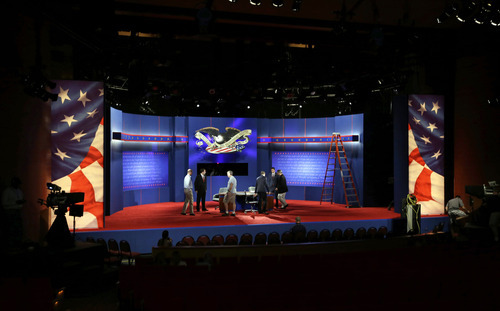 Technicians work on the stage during final preparations for Monday's presidential debate between President Barack Obama and Republican presidential candidate, former Massachusetts Gov. Mitt Romney, Sunday, Oct. 21, 2012, at Lynn University in Boca Raton, Fla. (AP Photo/Charlie Neibergall)