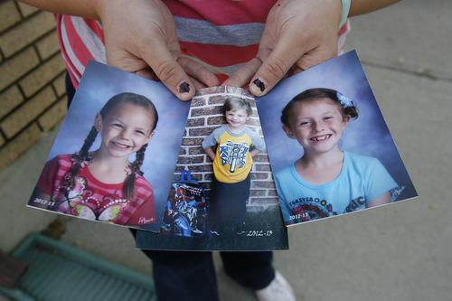 Utah aunt fights clock to adopt children from foster care the scott sommerdorf the salt lake tribune nina neubert of orem holds photos of ccuart Choice Image