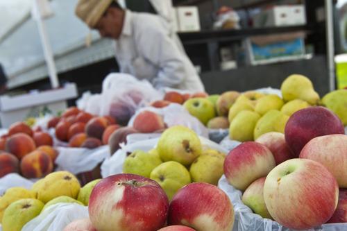 Chris Detrick     The Salt Lake Tribune Uriel Chavez sells apples from his Orem farm.