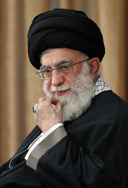 In this Monday, Oct. 15, 2012 photo, released by an official website of the Iranian supreme leader's office, Supreme Leader Ayatollah Ali Khamenei listens to a speaker during a meeting on a tour of northeastern Iran. Iranian officials have made no secret about their desire to reopen nuclear talks with the U.S. and other world powers as economic sanctions dig deeper -- with Iran's supreme leader even depicting his envoys as waiting at the negotiating table. (AP Photo/Office of the Iranian Supreme Leader)