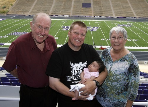 Rick Egan  | The Salt Lake Tribune   Ted Stanley, stands with his son Ted Stanley, who is holding his daughter, Emmerson (center) along his mother, Mary Ann (right) at Weber State, Friday, Aug. 10, 2012. Ted Stanley, a Weber State assistant football coach, is raising his infant, following the childbirth-related death of his wife, Jocelyn. His parents are helping him.