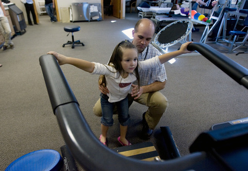 Kim Raff | The Salt Lake Tribune Kiarah McCoy does exercises with her physical therapist Josh Brown following surgery to rebuild her hip at Rock Run Physical Therapy & Rehab Specialists in Roy, Utah on October 10, 2012. The 4-year-old's hip dysplasia might have been easily fixed had it been caught earlier by her pediatrician. The last surgery, her third, is her mother Sarah McCoy's last hope for her daughter to regain mobility. But the family, though fully insured, is struggling to pay their medical bills.