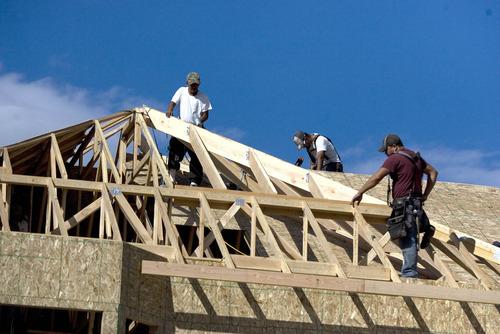 Paul Fraughton | The Salt Lake Tribune A framing crew works on a new home in Draper for Ivory Homes.