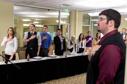 Trent Nelson  |  The Salt Lake Tribune Jen Comer leads the Weber State Student Senate in the national anthem to open their meeting on Oct. 1 at Weber State University in Ogden. Comer is the student senator representing veterans.