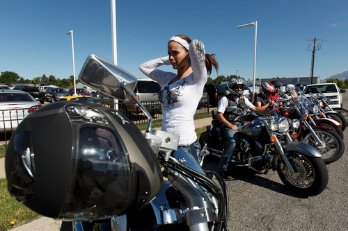 Trent Nelson     The Salt Lake Tribune Jen Comer joins a July motorcycle ride in Ogden to raise money for Weber County Sheriff Terry Thompson and Cache County Sheriff G. Lynn Nelson.