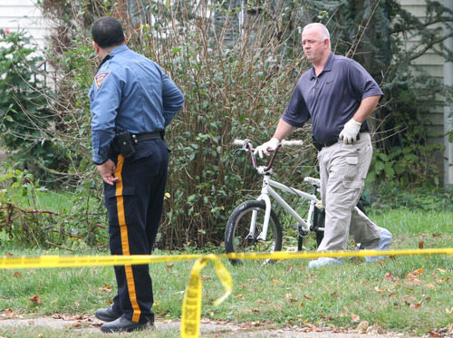Police remove a bicycle from a home near where a 12-year-old Autumn Pasquale's body was found in a recycling bin, Tuesday, Oct. 23, 2012 in Clayton, N.J. Authorities did not confirm the bike was the one belonging to Autumn Pasquale, but it matched the description of the white BMX she was seen riding Saturday afternoon before she disappeared. They also recovered a backpack they believe was hers. (AP Photo/Gloucester County Times, Tim Hawk)  PHILLY METRO OUT NEWS