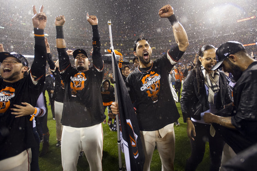 San Francisco Giants right fielder Gregor Blanco, catcher Hector Sanchez, center fielder Angel Pagan and relief pitcher Sergio Romo celebrate on the field following Game 7 of baseball's National League championship series against the St. Louis Cardinals, Monday, Oct. 22, 2012, in San Francisco. The Giants won 9-0. (AP Photo/The Sacramento Bee, Paul Kitagaki Jr.)