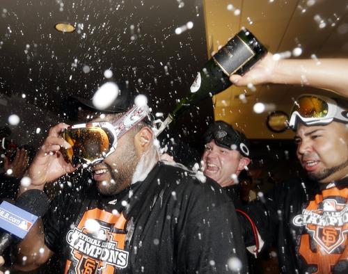 San Francisco Giants' Pablo Sandoval celebrates after Game 7 of baseball's National League championship series against the St. Louis Cardinals Monday, Oct. 22, 2012, in San Francisco. The Giants won 9-0 to win the series. (AP Photo/David J. Phillip)