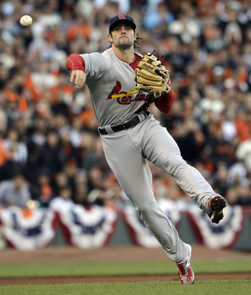 St. Louis Cardinals' Pete Kozma throws out San Francisco Giants' Buster Posey during the first inning of Game 7 of baseball's National League championship series Monday, Oct. 22, 2012, in San Francisco. (AP Photo/David J. Phillip)