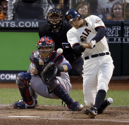 San Francisco Giants' Hunter Pence hits a three-run double during the third inning of Game 7 of baseball's National League championship series against the St. Louis Cardinals Monday, Oct. 22, 2012, in San Francisco. (AP Photo/Mark Humphrey)