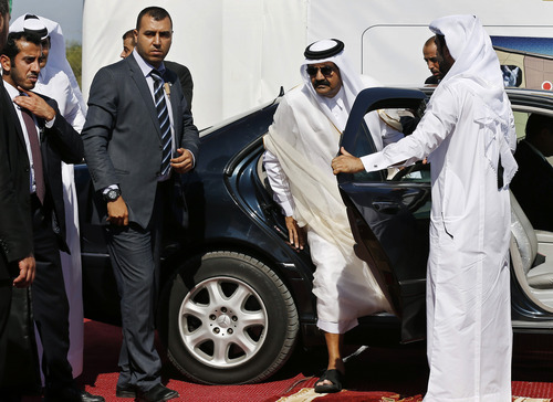 Emir of Qatar Sheikh Hamad bin Khalifa al-Thani steps out of a car as he arrives for the corner-stone laying ceremony for Hamad, a new residential neighborhood in Khan Younis, southern Gaza Strip Tuesday, Oct. 23, 2012. The emir of Qatar received a hero's welcome in Gaza on Tuesday, becoming the first head of state to visit the Palestinian territory since the Islamist militant Hamas seized control there in 2007. (AP Photo/Mohammed Salem, Pool)