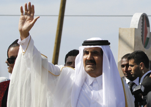 Emir of Qatar Sheikh Hamad bin Khalifa al-Thani waves to the crowd as he and and Gaza's Hamas prime minister Ismail Haniyeh, not pictured, arrive for corner-stone laying ceremony of a Qatari funded rehabilitation center in Gaza City,  Tuesday, Oct. 23, 2012. The emir of Qatar received a hero's welcome in Gaza on Tuesday, becoming the first head of state to visit the Palestinian territory since the Islamist militant Hamas seized control there in 2007. (AP Photo/Hatem Moussa, Pool)