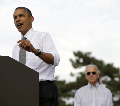 Vice President Joe Biden listens at right as President Barack Obama speaks during a campaign event at Triangle Park in Dayton, Ohio, Tuesday, Oct. 23, 2012, the day after the last presidential debate against Republican Presidential candidate, former Massachusetts Gov. Mitt Romney. (AP Photo/Pablo Martinez Monsivais)
