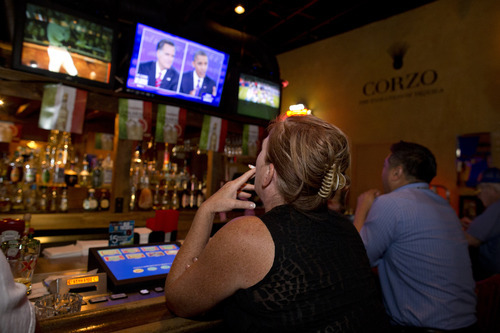 Sophia Peranteau watches the presidential debate at a local restaurant, Monday, Oct. 22, 2012, in Las Vegas. President Barack Obama and Republican candidate Mitt Romney squared off in the third and final debate focusing primarily on foreign policy before the general election on Nov. 6. (AP Photo/Julie Jacobson)