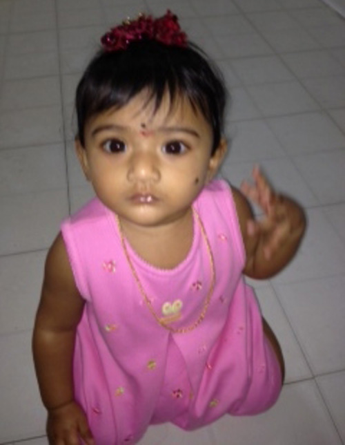 CORRECTS SPELLING OF GIRL'S NAME TO SAANVI, INSTEAD OF SAAVNI - This undated photo provided by the Montgomery County District Attorney's Office shows Saanvi Venna. Authorities are searching for the 10-month-old girl, who disappeared after her grandmother was fatally beaten inside a suburban Philadelphia apartment. Police issued an Amber Alert for the Venna on Monday Oct. 22, 2012 following the discovery of her grandmother's body at the Marquis Apartments in King of Prussia, Pa. (AP Photo/Montgomery County District Attorney's Office)