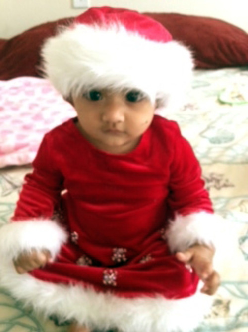 This undated photo provided by the Montgomery County District Attorney's Office shows Saavni Venna. Authorities are searching for the 10-month-old girl, who disappeared after her grandmother was fatally beaten inside a suburban Philadelphia apartment. Police issued an Amber Alert for the Venna on Monday Oct. 22, 2012 following the discovery of her grandmother's body at the Marquis Apartments in King of Prussia, Pa. (AP Photo/Montgomery County District Attorney's Office)