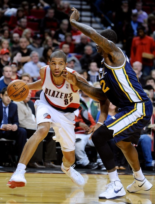 Utah Jazz' Marvin Williams (2) defends a drive by Portland Trail Blazers' Nicolas Batum (88) from France during the second half of an NBA preseason basketball game in Portland, Ore., Monday, Oct., 22, 2012. Batum had 27 points as the Trail Blazers beat the Jazz 120-114. (AP Photo/Greg Wahl-Stephens)
