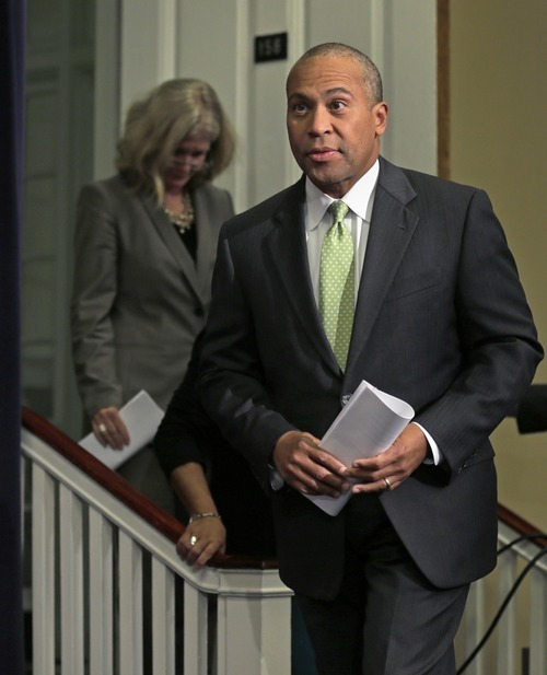 Mass. Gov. Deval Patrick arrives for a news conference regarding the Massachusetts pharmacy responsible for the meningitis outbreak during a news conference at the Statehouse in Boston, Tuesday, Oct. 23, 2012. The outbreak of meningitis, an inflammation of the lining of the brain and spinal cord, has sickened nearly 300 people, including 23 who died, in more than a dozen states. (AP Photo/Charles Krupa)