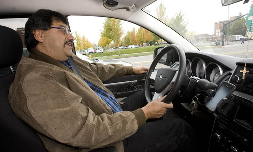 Paul Fraughton | The Salt Lake Tribune Raul Ramirez sits behind the wheel of his taxi. The owner of Utah Eagle Transport, Ramirez will be taking voters to the polls.  Tuesday, October 23, 2012