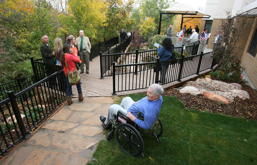 Steve Griffin | The Salt Lake Tribune Residents, visitors and staff of the Salt Lake City Veterans Nursing Home, at the VA Hospital, enjoy a new nature path, gazebo and outdoor area built this year. Supporters of the nursing home helped it win $25,000 in gift cards from Home Depot a year ago, and the Building Owners and Managers Association of Utah provided volunteer labor. The ceremony was held Tuesday October 23, 2012.