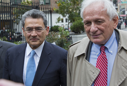 Former Goldman Sachs and Procter & Gamble Co. board member Rajat Gupta, center, arrives outside federal court in New York Wednesday, Oct. 24, 2012. Gupta is to be sentenced after being found guilty insider trading by passing secrets between March 2007 and January 2009 to a billionaire hedge fund founder who used the information to make millions of dollars. At right is Gupta's attorney Gary Naftalis. (AP Photo/Craig Ruttle)