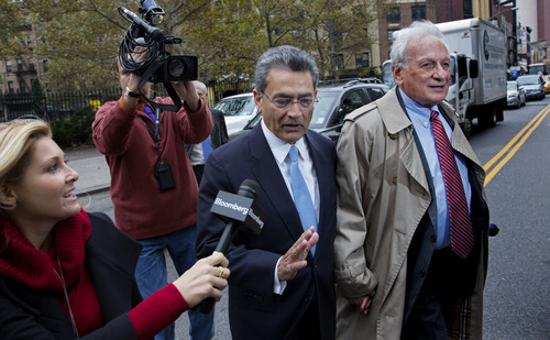 Former Goldman Sachs and Procter & Gamble Co. board member Rajat Gupta, center, declines to answer a question from a reporter as he arrives outside federal court in New York Wednesday, Oct. 24, 2012. Gupta is to be sentenced after being found guilty insider trading by passing secrets between March 2007 and January 2009 to a billionaire hedge fund founder who used the information to make millions of dollars. At right is Gupta's attorney Gary Naftalis. (AP Photo/Craig Ruttle)