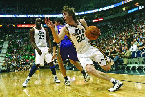 Chris Detrick  |  The Salt Lake Tribune  Utah Jazz small forward Gordon Hayward runs around Phoenix Suns shooting guard Matt Janning during a game at EnergySolutions Arena on Oct. 14, 2010.
