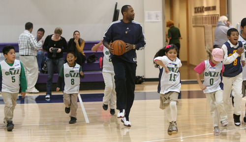 Steve Griffin | The Salt Lake Tribune  Mo Williams of the Utah Jazz runs kids from the U.S. Dream Academy through warmup drills during a private basketball clinic. About 55 children ages 8 to 14 attended the event at the Zions Bank Basketball Center in Salt Lake City on Wednesday, Oct. 24, 2012.
