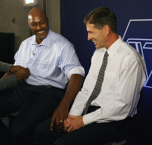 Steve Griffin | The Salt Lake Tribune   Karl Malone squeezes John Stockton's leg as they laugh together prior to the former  Jazz teammates' induction into the Utah Sports Hall Of Fame in Salt Lake City on Oct. 23, 2012.