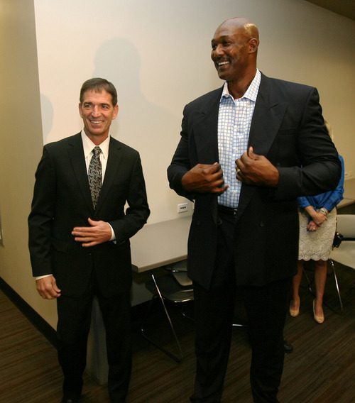 Steve Griffin | The Salt Lake Tribune   Karl Malone and John Stockton laugh together, at EnergySolutions Arena, prior to the former Jazz teammates' induction into the Utah Sports Hall Of Fame in Salt Lake City on Tuesday, Oct. 23, 2012.