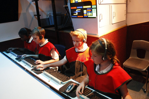 Chris Detrick  |  The Salt Lake Tribune  The Alpine School District has temporarily closed The Christa McAuliffe Space Education Center in Pleasant Grove. In this file photo in 2009, Baillie Brown, left, Alex Garrison, Cole Wright and Micaela West, sixth grade students at Renaissance Academy in Lehi participate in a space simulation on the U.S.S. Voyager NCC-1990.