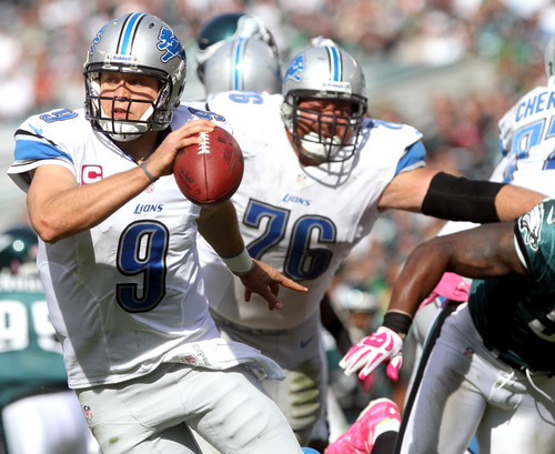 Detroit Lions quarterback Matthew Stafford (9) reverses his field to avoid the Philadelphia Eagles pass rush during an NFL football game, Sunday, Oct. 14, 2012, in Philadelphia. (AP Photo/The News Journal, Andre L. Smith)