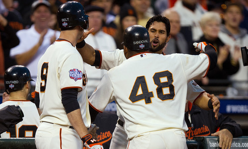 San Francisco Giants' Pablo Sandoval (48) celebrates with teammates at the dugout after hitting a home run against the Detroit Tigers during the fifth inning of baseball's World Series, Wednesday, Oct. 24, 2012, in San Francisco. (AP Photo/The Sacramento Bee, Jose Luis Villegas)  MAGS OUT; LOCAL TV OUT (KCRA3, KXTV10, KOVR13, KUVS19, KMAZ31, KTXL40); MANDATORY CREDIT