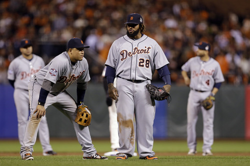 Detroit Tigers' Miguel Cabrera, left, and Prince Fielder wait during a pitching change in the seventh inning of Game 1 of baseball's World Series against the San Francisco Giants Wednesday, Oct. 24, 2012, in San Francisco. (AP Photo/Marcio Jose Sanchez)