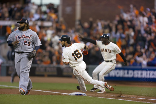San Francisco Giants' Angel Pagan (16) races past Detroit Tigers first baseman Prince Fielder (28) with a double during the third inning of Game 1 of baseball's World Series, Wednesday, Oct. 24, 2012, in San Francisco. (AP Photo/The Sacramento Bee, Paul Kitagaki Jr.) MAGS OUT; TV OUT (KCRA3, KXTV10, KOVR13, KUVS19, KMAZ31, KTXL40) MANDATORY CREDIT