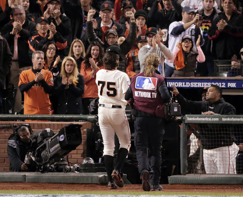 San Francisco Giants' Barry Zito leaves the game after pitching into the sixth inning of Game 1 of baseball's World Series against the Detroit Tigers, Wednesday, Oct. 24, 2012, in San Francisco. (AP Photo/Charlie Riedel)