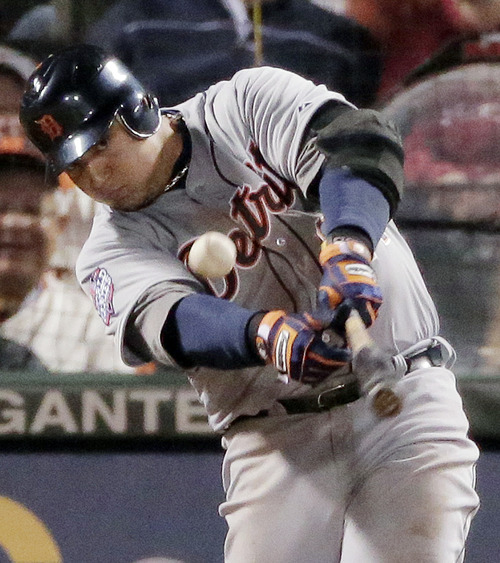Detroit Tigers' Miguel Cabrera hits an RBI single to score Austin Jackson during the sixth inning of Game 1 of baseball's World Series against the San Francisco Giants, Wednesday, Oct. 24, 2012, in San Francisco. (AP Photo/Charlie Riedel)
